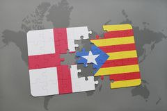 Puzzle with the national flag of england and catalonia on a world map background. Royalty Free Stock Photography