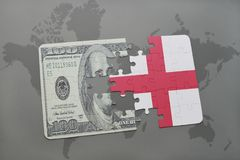 Puzzle with the national flag of england and dollar banknote on a world map background. Royalty Free Stock Photo