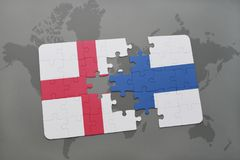 Puzzle with the national flag of england and finland on a world map background. Stock Image