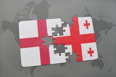 Puzzle with the national flag of england and georgia on a world map background. Royalty Free Stock Image