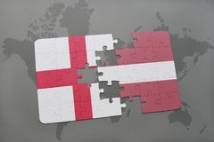 Puzzle with the national flag of england and latvia on a world map background. Royalty Free Stock Image