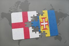 Puzzle with the national flag of england and madeira on a world map background. Stock Photo