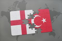 Puzzle with the national flag of england and turkey on a world map background. 3D illustration royalty free stock photography