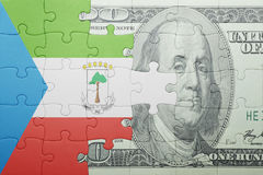 Puzzle with the national flag of equatorial guinea and dollar banknote Stock Photography