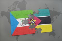 Puzzle with the national flag of equatorial guinea and mozambique on a world map. Background. 3D illustration Royalty Free Stock Images