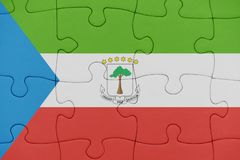 Puzzle with the national flag of equatorial guinea. Concept royalty free stock photos
