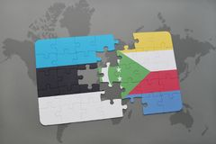 Puzzle with the national flag of estonia and comoros on a world map. Background. 3D illustration Royalty Free Stock Images