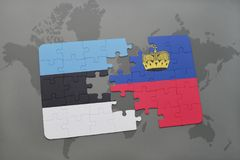 Puzzle with the national flag of estonia and liechtenstein on a world map background. Royalty Free Stock Images