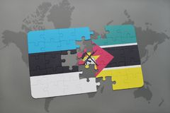 Puzzle with the national flag of estonia and mozambique on a world map. Background. 3D illustration Stock Photos