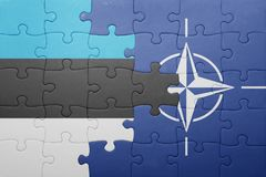 Puzzle with the national flag of estonia and nato. Concept stock photos