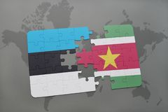 Puzzle with the national flag of estonia and suriname on a world map. Background. 3D illustration Royalty Free Stock Photography