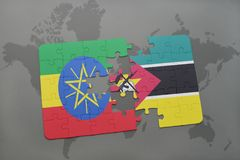 Puzzle with the national flag of ethiopia and mozambique on a world map Stock Photos