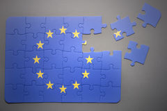 Puzzle with the national flag of european union. Broken puzzle with the national flag of european union on a gray background stock photo
