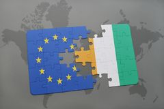 Puzzle with the national flag of european union and cote divoire on a world map background. 3D illustration stock image