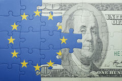 Puzzle with the national flag of european union and dollar banknote. Concept royalty free stock images