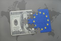 Puzzle with the national flag of european union and dollar banknote on a world map background. 3D illustration Royalty Free Stock Photo