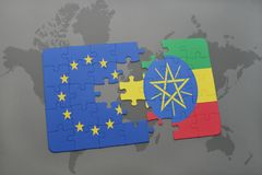 Puzzle with the national flag of european union and ethiopia on a world map background. 3D illustration royalty free stock photo