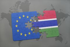 Puzzle with the national flag of european union and gambia on a world map background. 3D illustration royalty free stock images