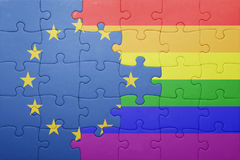 Puzzle with the national flag of european union and gay flag. Concept stock image