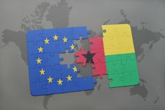 Puzzle with the national flag of european union and guinea bissau on a world map background. 3D illustration stock photos