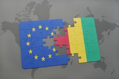 Puzzle with the national flag of european union and guinea on a world map background. 3D illustration royalty free stock images