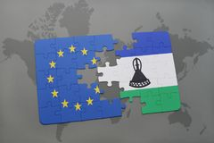 Puzzle with the national flag of european union and lesotho on a world map background. 3D illustration stock image