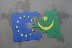 Puzzle with the national flag of european union and mauritania on a world map background. 3D illustration royalty free stock photography
