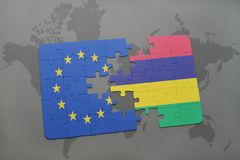 Puzzle with the national flag of european union and mauritius on a world map background. 3D illustration royalty free stock photos