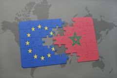 Puzzle with the national flag of european union and morocco on a world map background. 3D illustration stock images