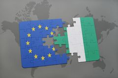 Puzzle with the national flag of european union and nigeria on a world map background. 3D illustration royalty free stock image