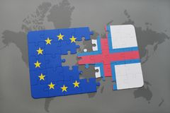 Puzzle with the national flag of faroe islands and european union on a world map. Background royalty free stock images