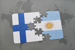 Puzzle with the national flag of finland and argentina on a world map background. Stock Photography