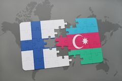 Puzzle with the national flag of finland and azerbaijan on a world map background. Royalty Free Stock Photo
