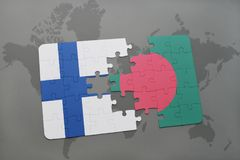 Puzzle with the national flag of finland and bangladesh on a world map background. 3D illustration Royalty Free Stock Images