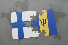Puzzle with the national flag of finland and barbados on a world map background. 3D illustration Stock Photo