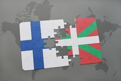 Puzzle with the national flag of finland and basque country on a world map background. 3D illustration Royalty Free Stock Photography