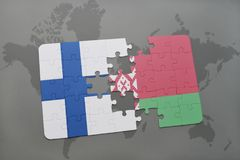 puzzle with the national flag of finland and belarus on a world map background. Stock Photo