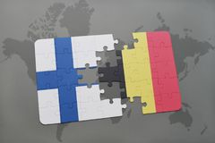 Puzzle with the national flag of finland and belgium on a world map background. 3D illustration Royalty Free Stock Photo