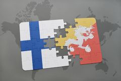 Puzzle with the national flag of finland and bhutan on a world map background. 3D illustration Royalty Free Stock Photo