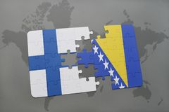 Puzzle with the national flag of finland and bosnia and herzegovina on a world map background. 3D illustration Royalty Free Stock Images