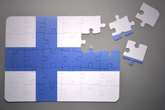 Puzzle with the national flag of finland Royalty Free Stock Photography