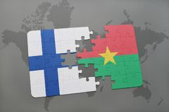 Puzzle with the national flag of finland and burkina faso on a world map background. 3D illustration Stock Photos