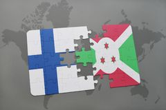 Puzzle with the national flag of finland and burundi on a world map background. 3D illustration Royalty Free Stock Images