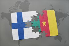 Puzzle with the national flag of finland and cameroon on a world map background. 3D illustration Stock Image