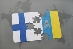 Puzzle with the national flag of finland and canary islands on a world map background. 3D illustration Royalty Free Stock Image