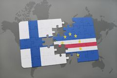 Puzzle with the national flag of finland and cape verde on a world map background. Royalty Free Stock Photography