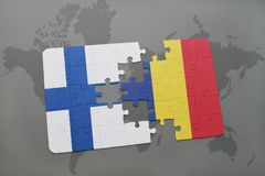 Puzzle with the national flag of finland and chad on a world map background. 3D illustration Stock Photography