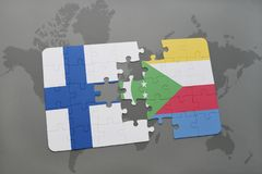 Puzzle with the national flag of finland and comoros on a world map background. 3D illustration Royalty Free Stock Image