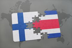 Puzzle with the national flag of finland and costa rica on a world map background. Royalty Free Stock Photo