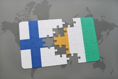 Puzzle with the national flag of finland and cote divoire on a world map background. 3D illustration Stock Photos